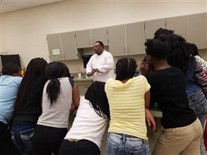 Mr. Shannon Miller, chef, with students